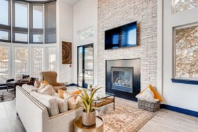 Clubroom living area with fireplace and TV