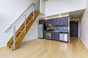 Loft kitchen with stainless steel appliances