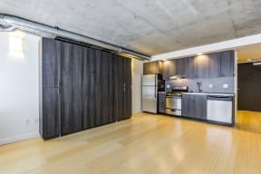 Studio layout with kitchen with stainless steel appliances