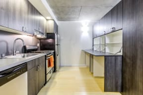 Kitchen with stainless steel appliances and storage space