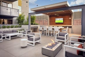 outdoor lounge with firepits and TV