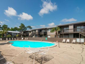 Pool at Atwood Oaks with an expansive sundeck and pool furniture.