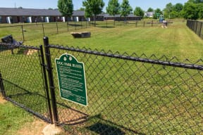 City Edge Flats Fenced-In Dog Park with Ample Green Space for Pets to Run and Play
