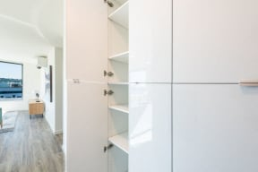 Storage Space With White Cabinetry at 10 Clay Apartments in Seattle, WA