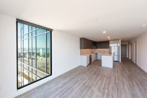 Contemporary Living Room With Large Windows at 10 Clay Apartments in Seattle, WA