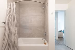 Large Bathroom Shower With Modern Details and Finishes at 10 Clay Apartments in Seattle, WA