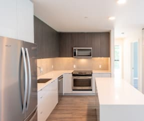 Wood-style Kitchen at 10 Clay Apartments