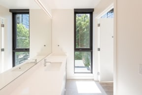 Master Bathroom with Long Window, Counter Space, Sink, All White Walls at 10 Clay Apartments in Seattle, Washington,98121