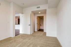 Bedroom door and entrance to bathroom