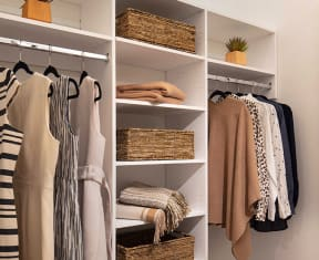 Walk-in closet with built in shelving at North+Vine, Chicago, IL, 60610