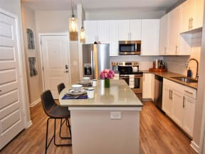 Gourmet Pointe at Lake CrabTree Kitchen With Island in Morrisville Apartments