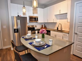 Fitted Pointe at Lake CrabTree Kitchen With Island Dining in North Carolina Apartments for Rent