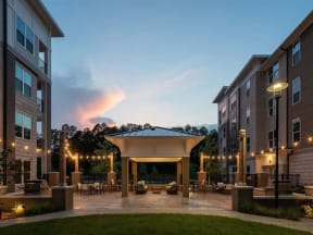 Outdoor Pointe at Lake CrabTree courtyard with fire pit in Morrisville Apartments