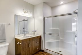 Bathroom with glass stand in shower tub combo