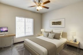Large main bedroom with king sized bed and desk