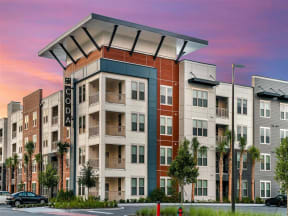 External view of Coda Orlando apartment rentals with spacious off-street parking spots in Orlando, FL