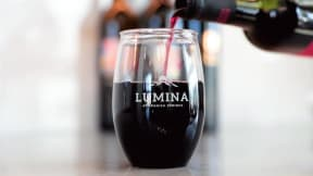 Lumina wine glass filled with red wine
