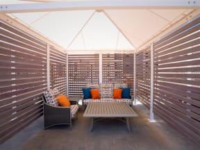 interior of pool cabana with seating and table