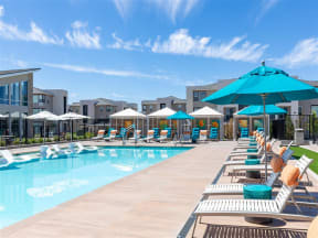 pool, lounge chairs and umbrellas