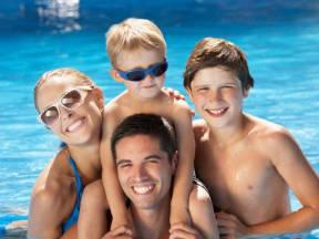 Family in Pool l Vineyard Gate Apartments in Roseville CA
