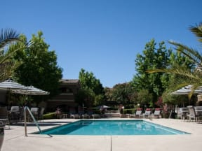 pool and lounge chairs  l Vineyard Gate Apartments in Roseville CA