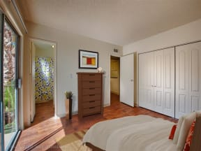 Private Master Bedroom With Attached Balcony at Fountain Plaza Apartments, Tucson, Arizona