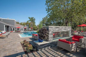 pool fireplace with seating Apartments in Pittsburg, CA l Kirker Creek Apartments