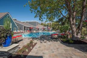 Pool with seating Pittsburg Apartments - Kirker Creek in CA Pool
