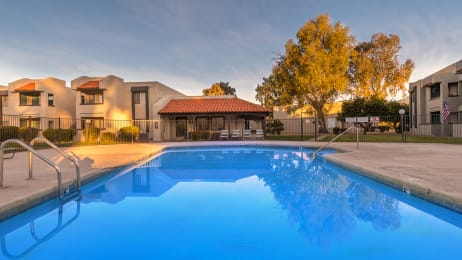 Riverstone pool view with nice view, and lounging area nearby