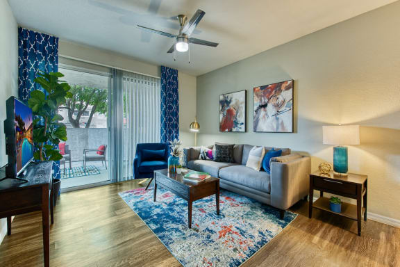Apartments for Rent in Mesa, AZ - Envision Apartments Living Room with Wood-Style Plank Flooring and Sliding Glass Door Leading to Patio