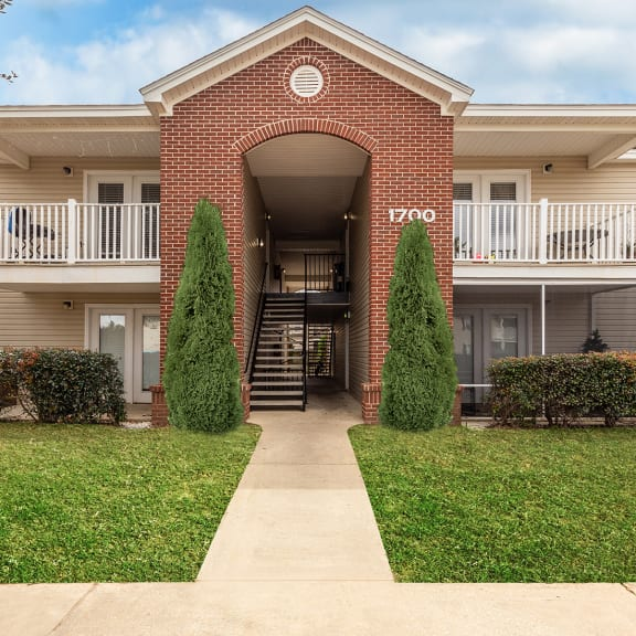 Park Place building exterior with brick walls and patios in Foley, AL