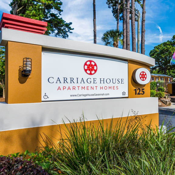 Exterior entrance sign for Carriage House apartment homes in Savannah, GA