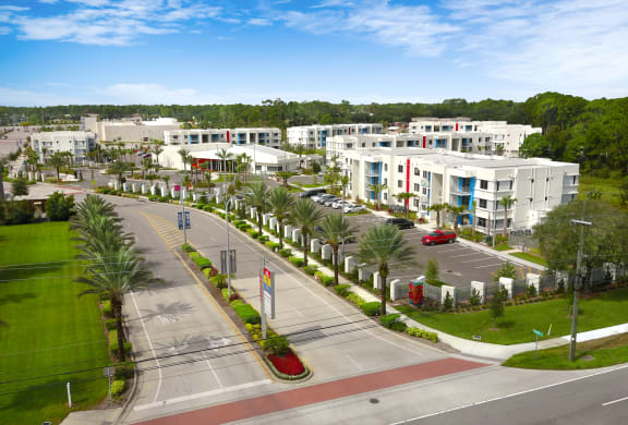 East entry aerial into Icon One Daytona Apartments
