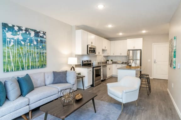 Spacious Living Room and Kitchen With Wood Flooring at The Barnum Apartments in White Bear Lake, MN