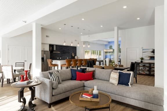 Bright clubroom with large grey sectional at Waterstone Place in Minnetonka, MN 55305