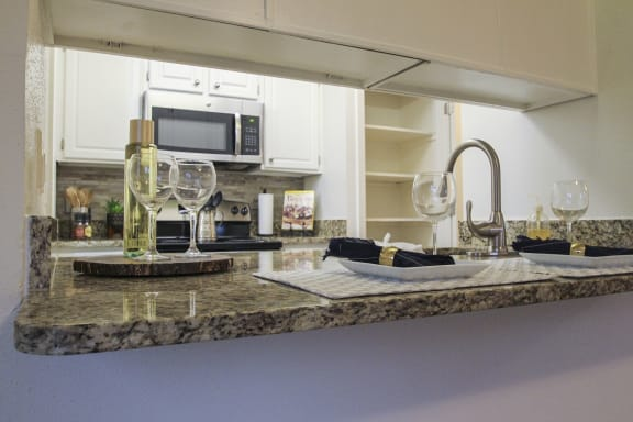 This is a photo of the kitchen of a 1245 square foot 2 bedroom apartment at Cambridge Court Apartments.