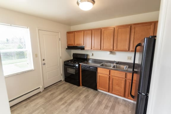 This is a photo of the kitchen in the 1004 square foot, 2 bedroom, 1.5 bath townhome floor plan at Lake of the Woods Apartments in Cincinnati, OH.