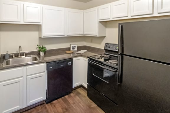 This is a photo of the kitchen of a 742 square foot, 2 bedroom apartment at Romaine Court Apartments in Cincinnati, Ohio.