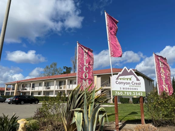 Canyon Crest Property sign and welcome flags