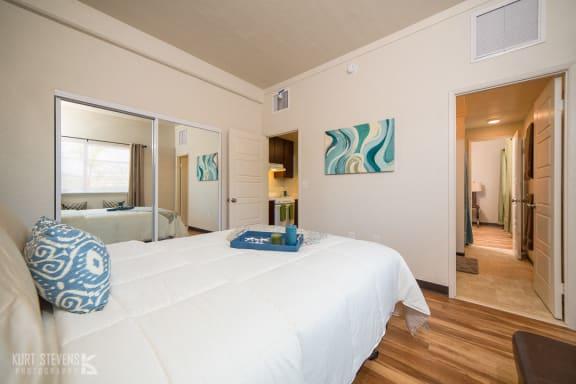 Wakea Garden Apartments bedroom with decor and closet with mirror doors