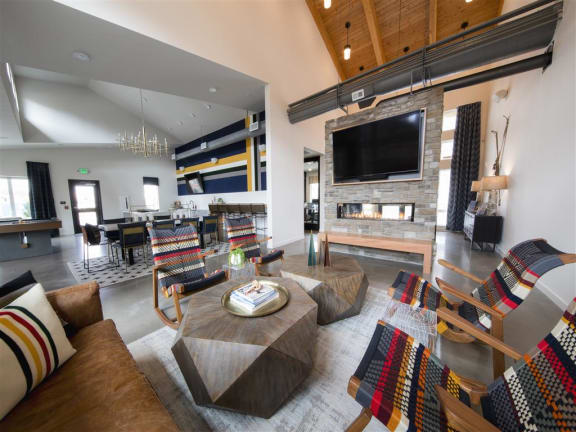 Cozy resident lounge area with tv and fireplace.