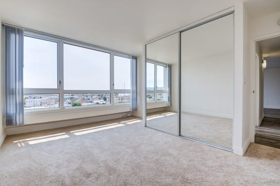 One-Bedroom Apartments in Downtown Oakland, CA - Merritt on 3rd Apartments Bedroom with Large Windows and Spectacular View