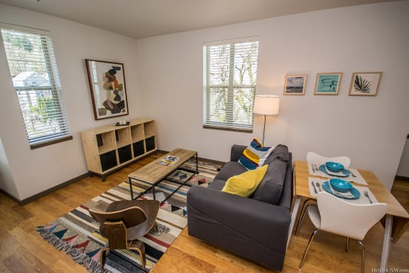 Apartments in Portland, OR - Living Room With Stylish Decor, Hardwood Flooring, and Access to Outdoor Patio