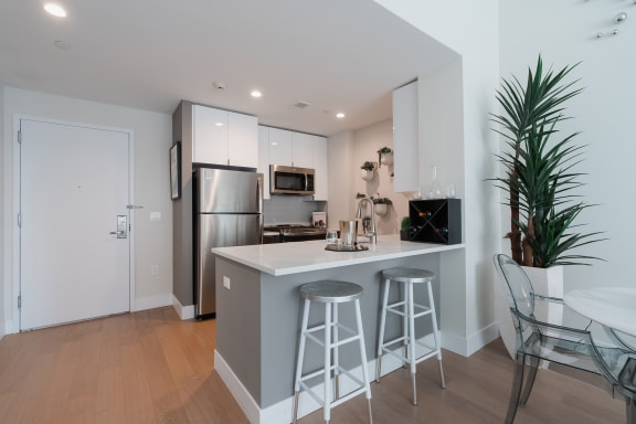 Kitchen with Light Finishes featuring Island at Continuum 55, White Plains, NY 10606