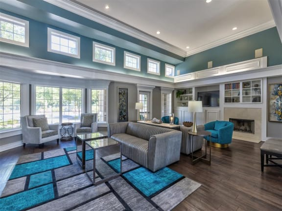 Club Room With Large Screen Tvs And A Fireplace at Summerwood on Towne Line, Indiana, 46268