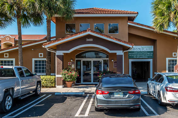 Leasing office building exterior and parking lot-Allapattah Gardens, Miami, FL