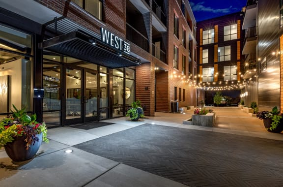 West 38 Apartments Exterior Entrance at Night