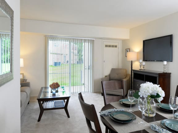 Living room with patio at Seven Oaks Townhomes