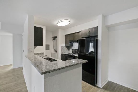 Kitchen counter and appliances at Brenton at Abbey Park Apartments in West Palm Beach FL