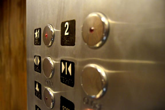 elevator buttons at Hancock Terrace Apartments, Santa Maria, CA